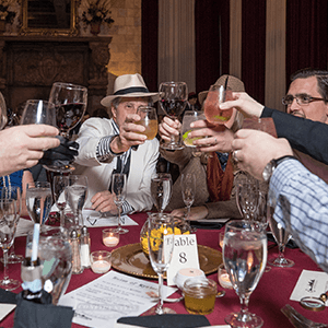 Miami Murder Mystery guests raise glasses